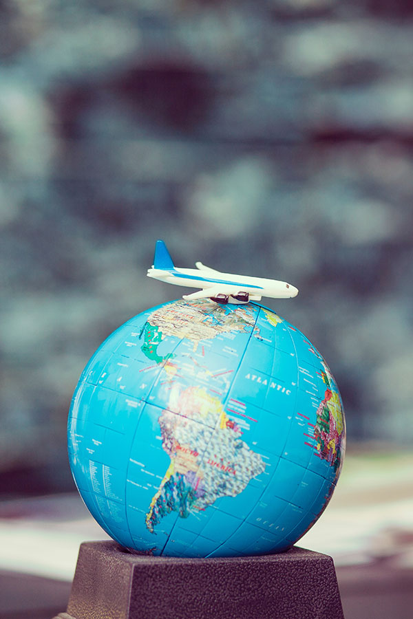 globe and toy plane