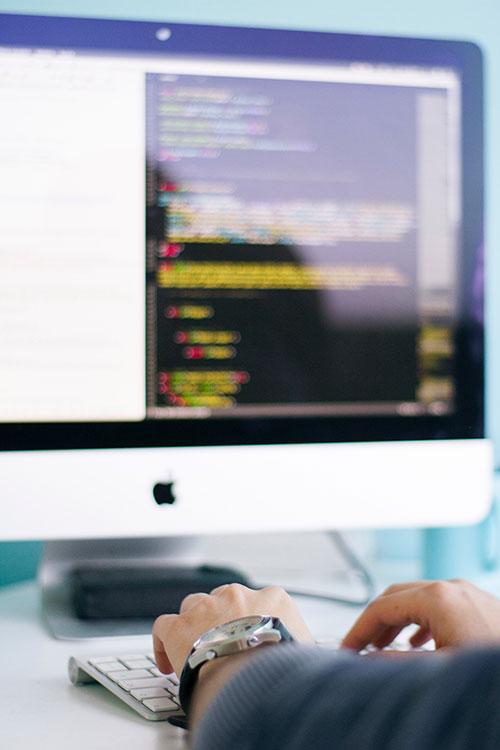 someone coding on desktop